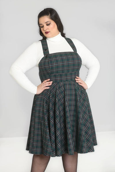 Plus size Hell Bunny green tartan Peebles pinafore dress modeled close up