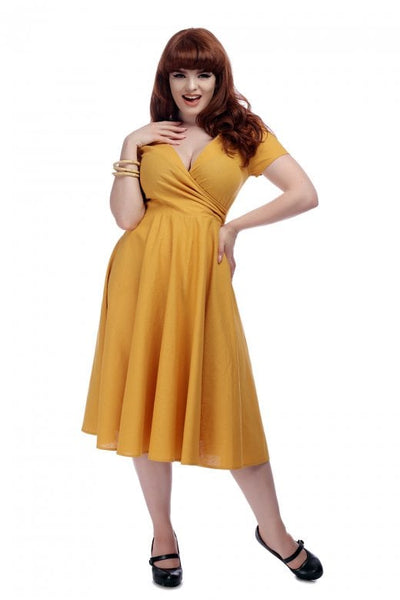 Collectif Maria dress in mustard modelled NZ