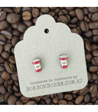 red coffee cup earrings on packaging