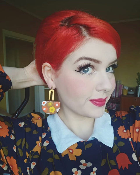 Miss Flossypots wearing Kik dangle earrings