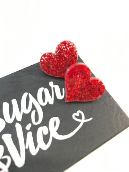 Sugar and vice red sparkly heart stud earrings on gift box NZ