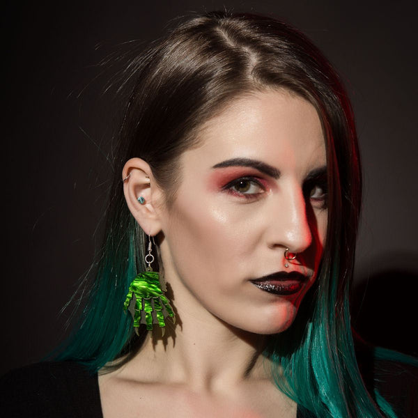 gill man monster earrings Sugar & Vice modeled