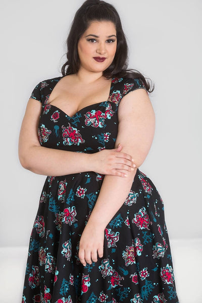 plus size Hell Bunny Poseidon 50s dress modelled close up arms crossed