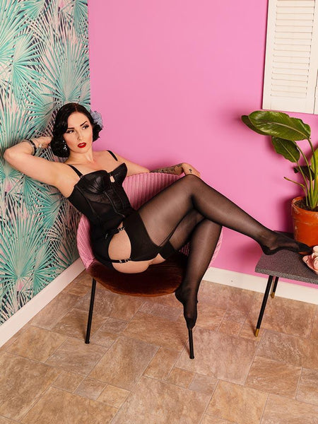 WHat Katie Did 40 denier black seamed stockings modeled in chair