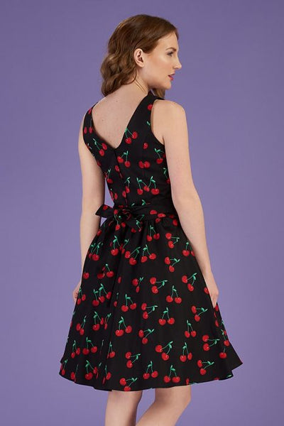 Lady dress tea dress cherry print back modeled.