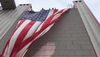 Woman arrested after burning US flag in 9/11 memorial on VA overpass