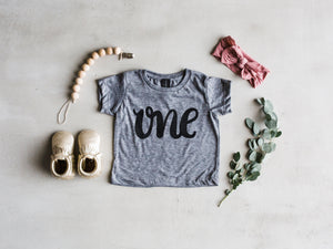 """One"" First Birthday Baby Tee"
