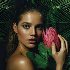 Pure Wild Skincare, model holding protea flower