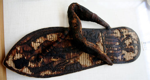 Tutankhamun's sandal decorated with bound prisoners and sema-tawy symbols