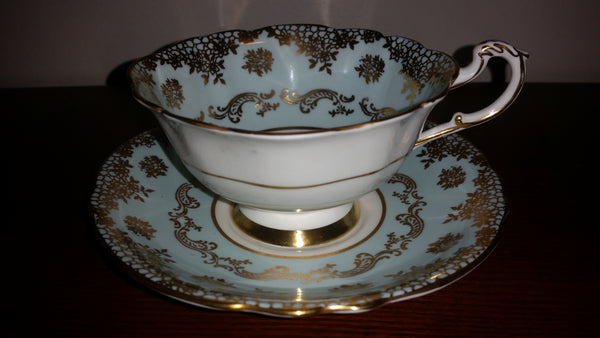 1950s Paragon Teal (light Blue) Tea Cup and Saucer w/ Gold Trim and Gold Snowflake Design - Treasure Valley Antiques & Collectibles
