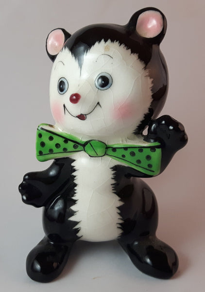 1950s Blushing Skunk with Green Polka Dot Bow Tie - Treasure Valley Antiques & Collectibles