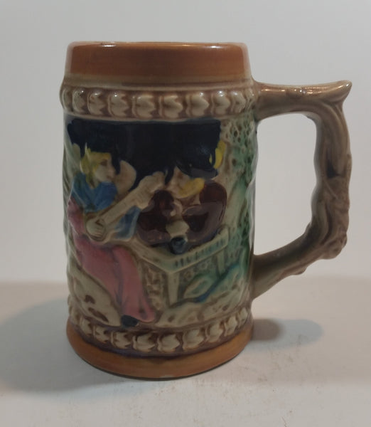 1950s German Oktoberfest Beer Stein Woman Playing Instrument with Man in Hat Made in Japan. - Treasure Valley Antiques & Collectibles
