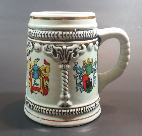 Vintage Enesco Japan Light Blue Embossed Coat of Arms Gold Trim Beer Stein - Treasure Valley Antiques & Collectibles