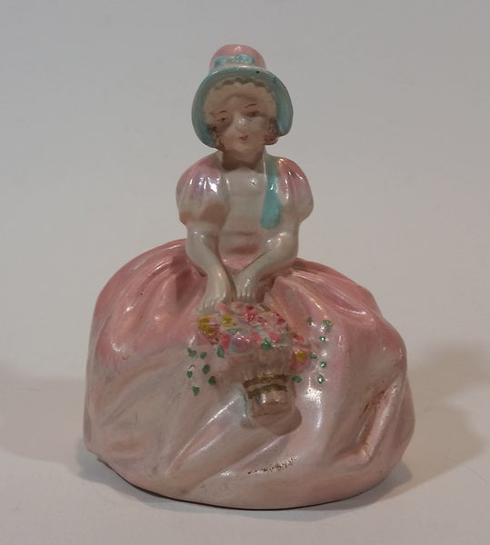 Vintage Chalkware Sitting Girl in Victorian Pink Dress with Bonnet and Flower Basket Figurine - Treasure Valley Antiques & Collectibles