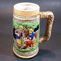 "1950s German Oktoberfest Beer Stein Woman Serving Beer to Man Sitting - Japan 6 3/8"" Tall - Treasure Valley Antiques & Collectibles"