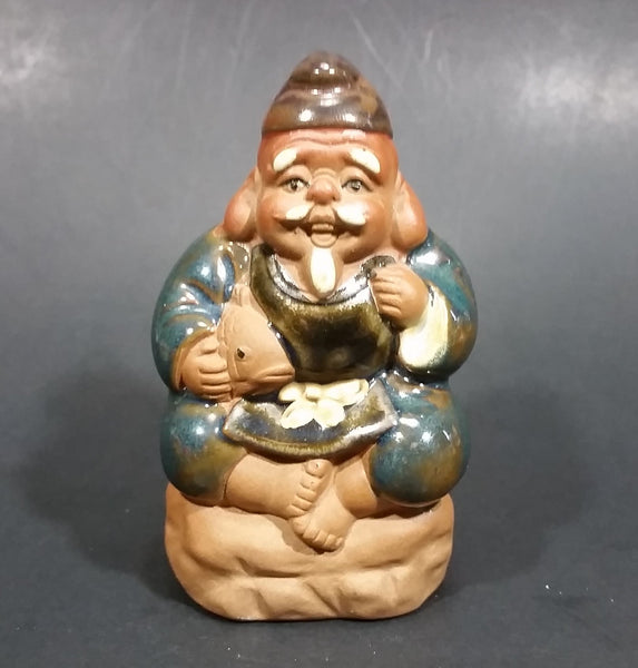 1960-1980 Inarco Japan Man Sitting on a Rock with a Fish Ceramic Figurine E-5900