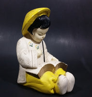 Vintage Chalkware Asian Child in Yellow Hat Sitting and Reading a Book Figurine - Treasure Valley Antiques & Collectibles
