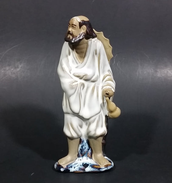 Vintage Balding Man with a Beard in a White Robe With a Tan Hat Ceramic Figurine - Treasure Valley Antiques & Collectibles