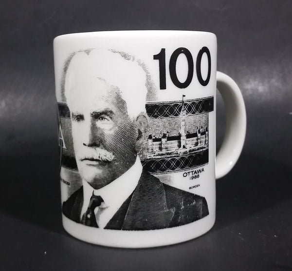Novelty Collectible 1986 $100 Canadian Bill Currency Cash Money Ceramic Coffee Mug - Treasure Valley Antiques & Collectibles