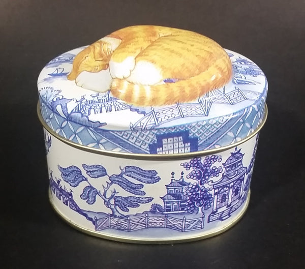 Collectible Blue Willow Blue and White Tin With Orange and White Sleeping Kitty Cat - Treasure Valley Antiques & Collectibles