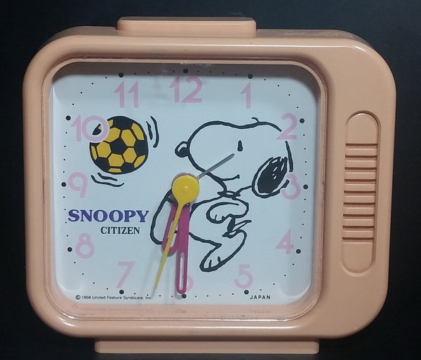 Vintage 1958 Citizen United Feature Syndicate Snoopy Playing Soccer Pink Alarm Clock Collectible