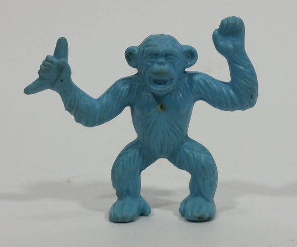 Vintage 1980s Diener Inc Light Blue Monkey Holding up A Banana Eraser Collectible - Treasure Valley Antiques & Collectibles