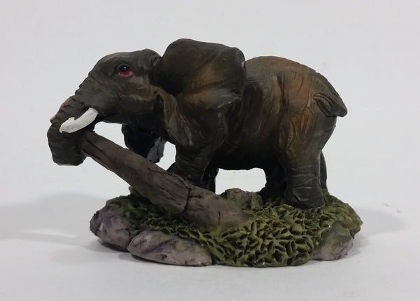Elephant with Tusks Pulling a Log With It's Trunk Resin Figurine - SABRE - Treasure Valley Antiques & Collectibles