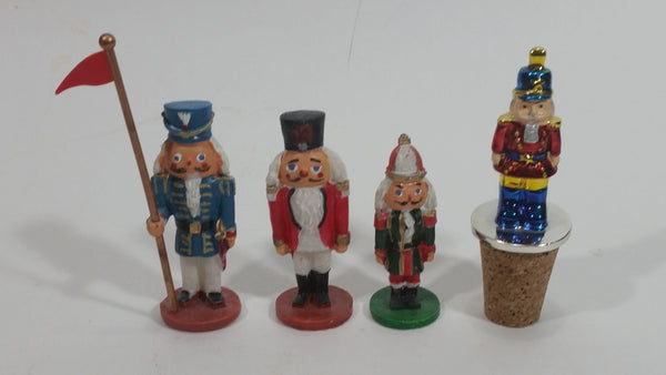 Three Small Christmas Nutcracker Figures and One Bottle Cork Nutcracker