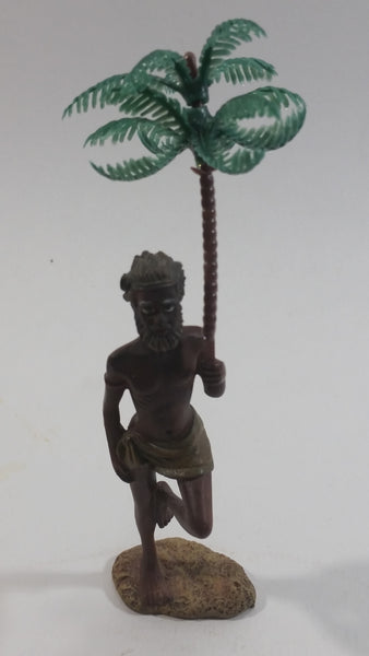 Man Holding a Palm Tree Umbrella While Standing on One Foot Resin and Plastic Figurine