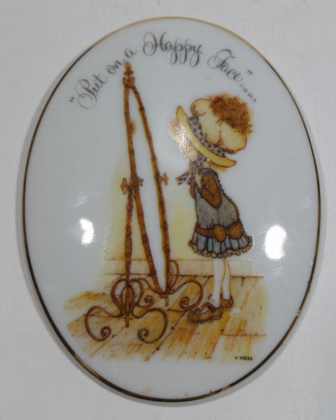 "Vintage Holly Hobbie ""Put on a Happy Face"" Oval Porcelain Wall Hanging W.W.A. - Treasure Valley Antiques & Collectibles"