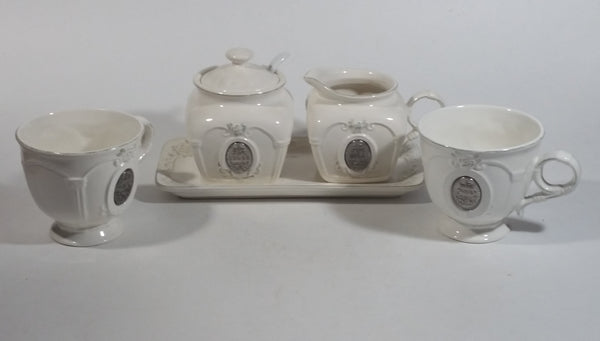 Bombay Company White Embossed Floral Design Creamer, Sugar Bowl, Tea Cup Set
