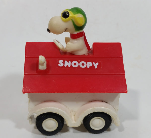 Vintage 1975 Aviva Snoopy Doghouse Motorized Friction Pullback Plastic Toy Car Vehicle