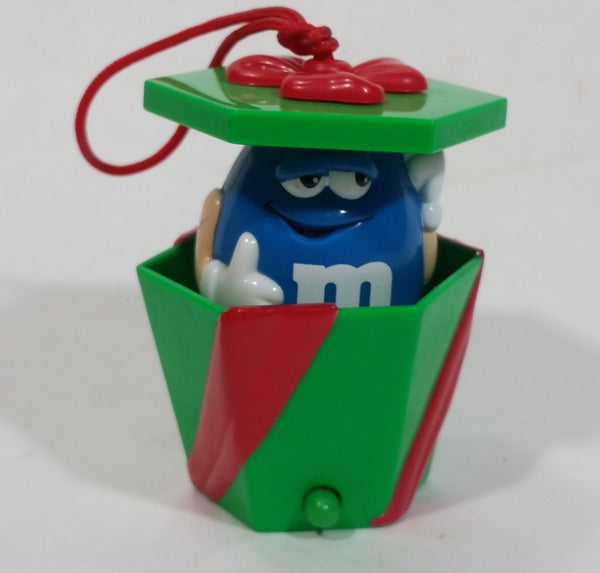 Mars M&M's Chocolate Peanut Candies Pop Up Blue Character in Green Red Ribbon Wrapped Present Gift Christmas Tree Hanging Ornament