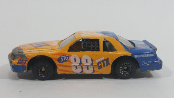 Vintage Zee Toys Dyna Wheels Ford Thundebird Stock Car #88 STP GTX D101 Orange and Blue Die Cast Toy Race Car Vehicle