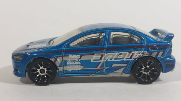 2010 Hot Wheels Night Burnerz 2008 Lancer Evolution Metallic Blue Die Cast Toy Car Vehicle