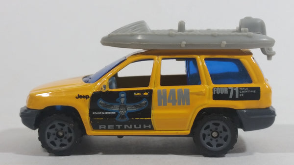 1999 Matchbox Jeep Grand Cherokee Yellow with Grey Raft Die Cast Toy Car Vehicle