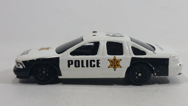 Yatming Chevy Caprice No. 823 Police Officer Cop #19 White Black Die Cast Toy Car Emergency Rescue Vehicle
