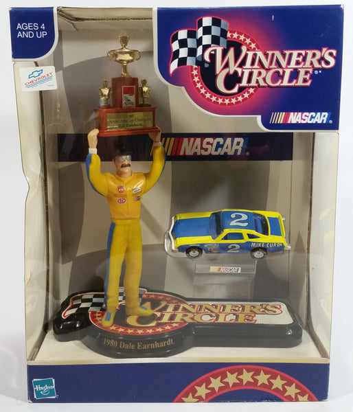 "1999 NASCAR Winner's Circle 1980 Champion Dale Earnhardt 7 1/2"" Figure with 1/64 Scale Chevrolet Monte Carlo #2 Die Cast Toy Car Vehicle In Original Packaging"