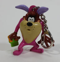 WBEI Warner Bros Looney Tunes Taz Wearing a Pink Easter Bunny Costume with Green Basket PVC Figurine Keychain Cartoon Collectible
