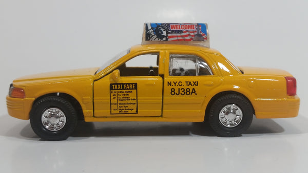 Shing Fat Welcome to N.Y.C. Yellow Taxi Cab Pullback Friction Motorized Die Cast Toy Car Vehicle with Opening Doors 1/40 Scale