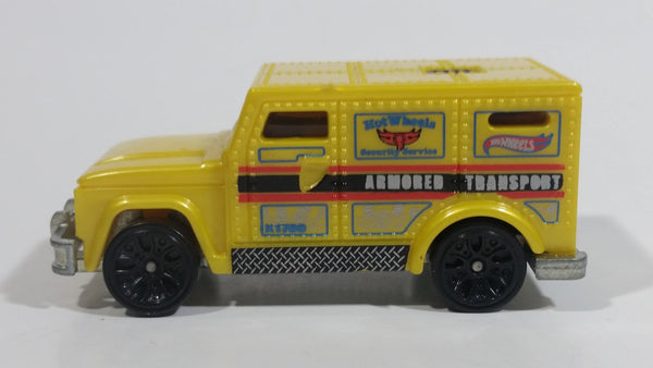 2013 Hot Wheels HW City City Works Armored Transport Yellow Plastic Body Die Cast Toy Car Vehicle