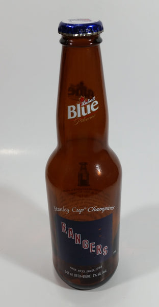 "Labatt Blue Pilsner NHL Ice Hockey Stanley Cup Champions New York Rangers 8 3/4"" Tall Amber Glass Beer Bottle with Cap"
