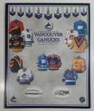 "NHL Ice Hockey Vancouver Canucks Team Jersey and Arena History 10 3/4"" x 13 1/4"" Hardboard Wall Plaque"