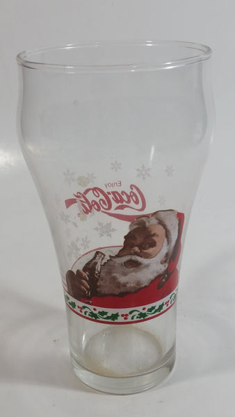 "Enjoy Coca-Cola Santa Claus Holding a Bottle with Snowflakes and Holly Border Christmas Holiday Themed 6"" Tall Glass Cup"