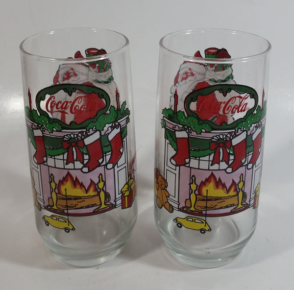 "1980s McCrory Stores Inc Set of 2 Coca-Cola Santa Claus Fireplace with Stockings and Toys Christmas Holiday Themed 6"" Tall Glass Cup"