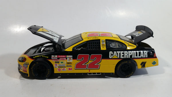 2001 Racing Champions Nascar #22 Ward Burton CAT Financial Dodge R/T Yellow and Black 1/24 Scale Die Cast Model Toy Race Car Vehicle with Opening Hood and Trunk