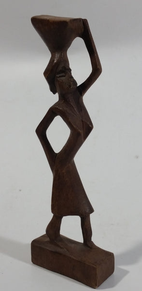 "Vintage Man Carrying Container On Head 6 1/2"" Tall Wood Carving"
