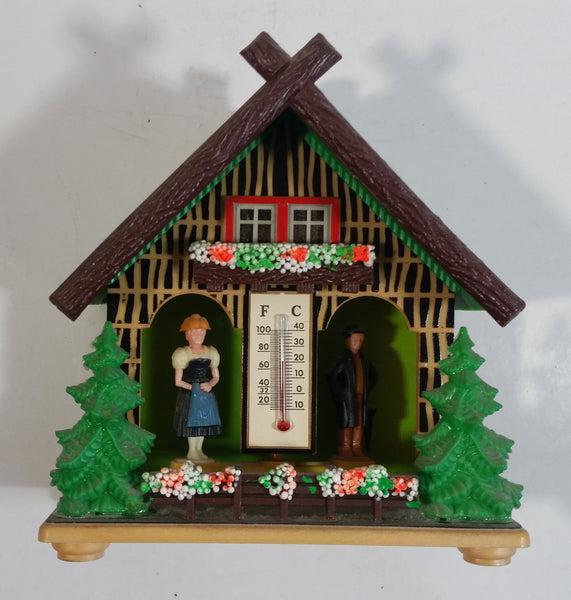 "Vintage Western Germany Christmas Themed Black Forest Bavarian House Homestead Shaped Wooden and Plastic Thermometer with Man and Woman 5"" Tall"