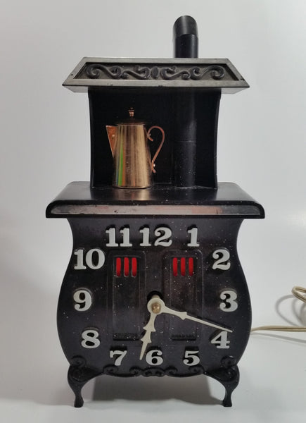 Vintage Spartus Antique Style Black Pot Belly Stove Shaped Electric Plugin Clock