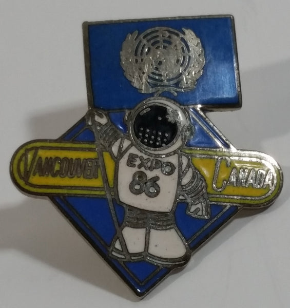 1986 Vancouver Exposition Expo 86 Ernie The Astronaut with UN United Nations Flag Metal Lapel Pin